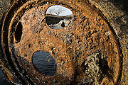 A rusted car wheel in the Truckee River at McCarran Ranch near Reno, Nevada. The ranch is one of three properties so far being restored in a $20 million effort by the Nature Conservancy to revitalize the Lower Truckee River ecosystem.