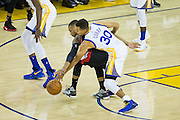 Golden State Warriors guard Stephen Curry (30) attempts to pick the ball from the Portland Trail Blazers at Oracle Arena in Oakland, Calif., on October 21, 2016. (Stan Olszewski/Special to S.F. Examiner)