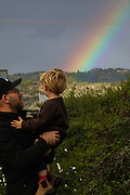 Father is showing a beautiful Rainbow to his son. Photographed on the Israeli Lebanese Border in winter December