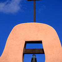 USA, New Mexico, Santa Fe. Bell and cross at San Ildefonso Pueblo.