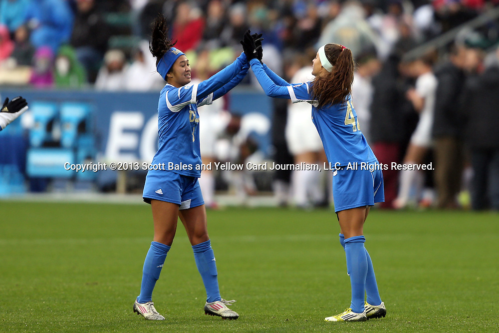 08 December 2013: UCLA's Caprice Dydasco (3) and Ally Courtnall (42). The Florida State University Seminoles played the University of California Los Angeles Bruins at WakeMed Stadium in Cary, North Carolina in a 2013 NCAA Division I Women's College Cup championship game. UCLA won the game 1-0 in overtime.