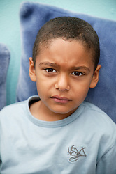 Portrait of a young boy looking upset,