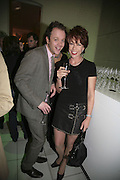 Johnnie Harvey and Kathy Lette, Colman Getty's 20th Birthday party. The Imagination Gallery. Store St. London W1. 17 January 2006.  -DO NOT ARCHIVE-© Copyright Photograph by Dafydd Jones. 248 Clapham Rd. London SW9 0PZ. Tel 0207 820 0771. www.dafjones.com.