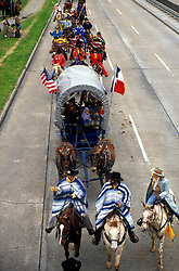 Trail riders on wagons going through Houston
