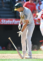 April 8, 2018 - Anaheim, CA, U.S. - ANAHEIM, CA - APRIL 08: Oakland Athletics first baseman Matt Olson (28) throws his bat after striking out in the seventh inning of a game against the Los Angeles Angels of Anaheim played on April 8, 2018 at Angel Stadium of Anaheim in Anaheim, CA (Photo by John Cordes/Icon Sportswire) (Credit Image: © John Cordes/Icon SMI via ZUMA Press)