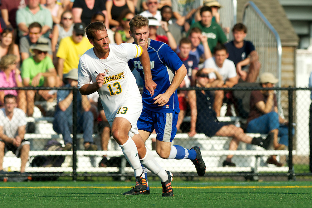 Catamounts defenseman Seth Rebeor (13) in action during the men's soccer game between the Central Connecticut State University Blue Devils and the Vermont Catamounts at Virtue Field on Friday afternoon September 7, 2012 in Burlington, Vermont.