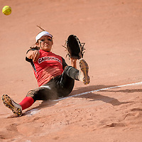 St. Michael Indian School Cardinal Alex Nez (3) fires a throw to first base from Miyamura Patriot infield ground ball during the Wingate Softball Slam tournament at Ford Canyon Park in Gallup Friday.
