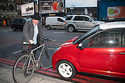BORIS JOHNSON, Gavin Sherriff reviewing the Aixam mega coupe which runs on a moped engine. London. 9 January 2012