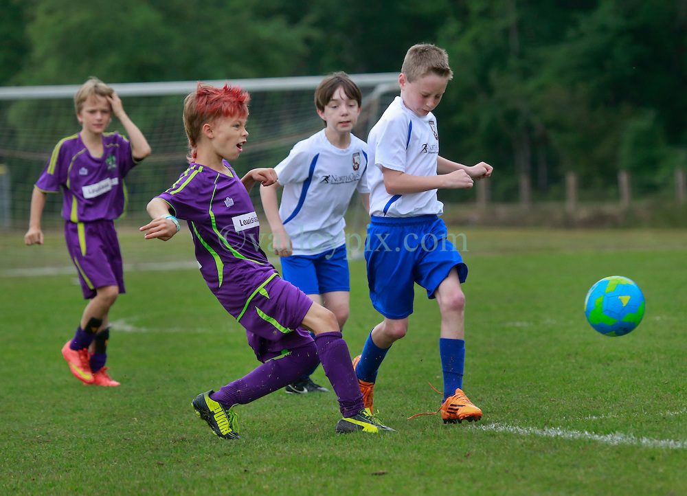 11 April 2015. Hammond, Louisiana.<br /> U10 New Orleans Jesters Elites, team purple play STYSA Scorpions at the Strawberry Cup hosted by the South Tangipahoa Youth Soccer Association (STYSA). Jesters emerged victorious with a 13-0 win.<br /> Photo; Charlie Varley/varleypix.com