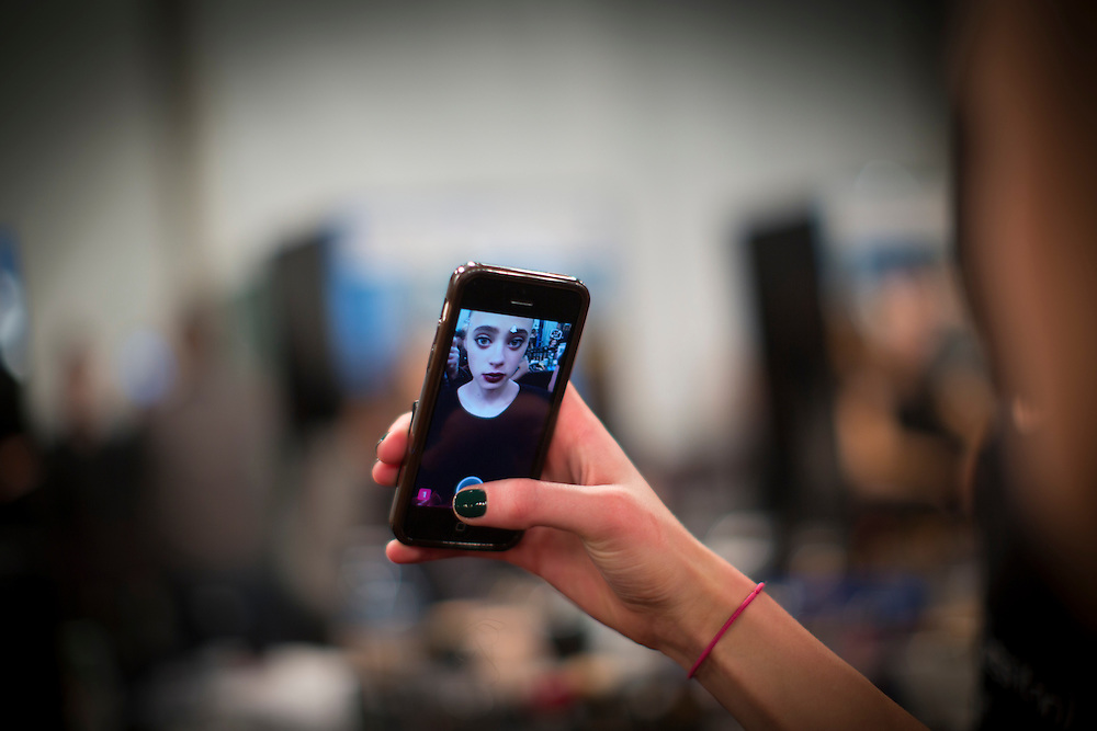 TORONTO, ON - MARCH 14: A model takes a selfie backstage while in hair and makeup before the Narces show during Toronto Fashion Week in Toronto, Ontario. Toronto Star/Todd Korol
