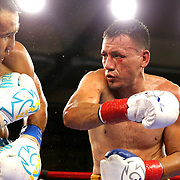 """Kanat """"QazaQ"""" Islam of Almaty, Kazakhstan defends against a punch by Noroberto """"Demonio"""" Gonzalez of Monterrey, Mexico. Islam went on to win the NABO Jr. Middle Weight Title during a Nelsons Promotions boxing match at the Boca Raton Resort  and Club on Friday, May 26, 2017 in Boca Raton, Florida.  (Alex Menendez via AP)"""