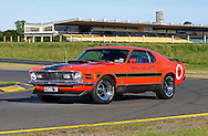 1970 Ford Mustang Mach 1 Sportsroof -  Calypso Coral.American Raceway's Inc Texas International Speedway Pace Car .Sandown Raceway, Springvale, Victoria.7th January 2012.(C) Joel Strickland Photographics..Use information: This image is intended for Editorial use only (e.g. news or commentary, print or electronic). Any commercial or promotional use requires additional clearance.