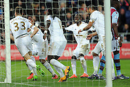 Swansea players celebrate with goalscorer Federico Fernandez (33). Barclays Premier league match, Swansea city v Aston Villa at the Liberty Stadium in Swansea, South Wales on Saturday 19th March 2016.<br /> pic by  Carl Robertson, Andrew Orchard sports photography.