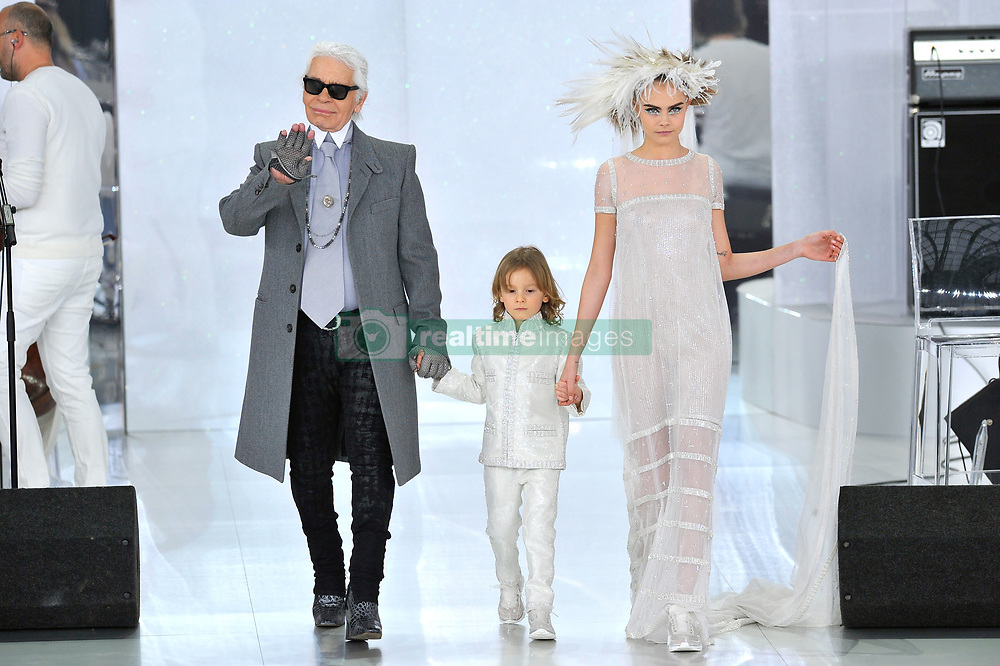 File photo - Designer Karl Lagerfeld, his godson Hudson Kroenig and Model Cara Delevingne walk at the end of Chanel Spring-Summer 2014 Haute-Couture collection show held at the Grand Palais, in Paris, France on January 21, 2014. Karl Lagerfeld died on Monday at age 85. One who may inherit is his godson Hudson. Hudson's dad, model Brad Kroenig, is like 'family' to Lagerfeld. Hudson began modeling for Chanel at age two and had continued to pop up on the runway ever since. Photo by Thierry Orban/ABACAPRESS.COM
