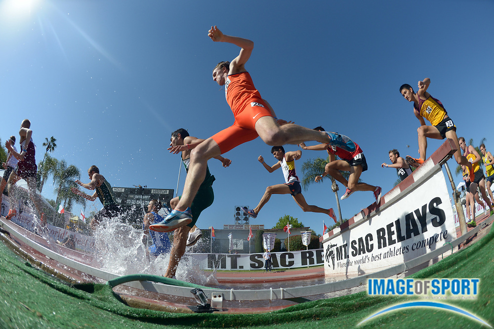 Apr 18, 2013; Walnut, CA, USA; Runners race over the water jump in the steeplechase  in the 55th Mt. San Antonio College Relays at Hilmer Lodge Stadium.