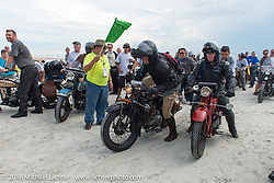 Ryan Allen with his 1929 Indian 101 Scout along with his friend Kirk MacGillivray on his 1928 Indian Scout pass through the start on the sands of Daytona Beach at the beginning of stage1 of the Motorcycle Cannonball Cross-Country Endurance Run, which on this day ran from Daytona Beach to Lake City, FL., USA. Friday, September 5, 2014.  Photography ©2014 Michael Lichter.
