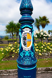 Detail of ornate lamppost with coat of arms of Rothesay in Rothesay winter gardens , Isle of Bute, Argyll and Bute, Scotland, UK