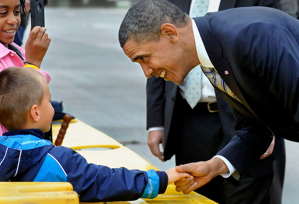 President Obama shakes the hand of Joe Guida, left, as he arrives at the Bradley Air National Guard Base in East Granby, Conn. The President is in Connecticut to speak at the U.S. Coast Guard Academy's 130th commencement. (AP Photo/Jessica Hill)