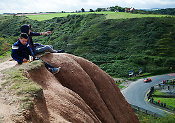 © Licensed to London News Pictures. <br /> 10/09/2017 <br /> Saltburn by the Sea, UK.  <br /> <br /> Two youngsters sit watching events during the annual Saltburn by the Sea Historic Gathering and Hill Climb event. Organised by Middlesbrough and District Motor Club the event brings together owners of a wide range of classic cars and motorcycles dating from the early 1900's to 1975. Participants take part in a hill climb to test their machines up a steep hill near the town. Once held as a competitive gathering a change in road regulations forced the hill climb to become a non-competitive event.<br /> <br /> Photo credit: Ian Forsyth/LNP