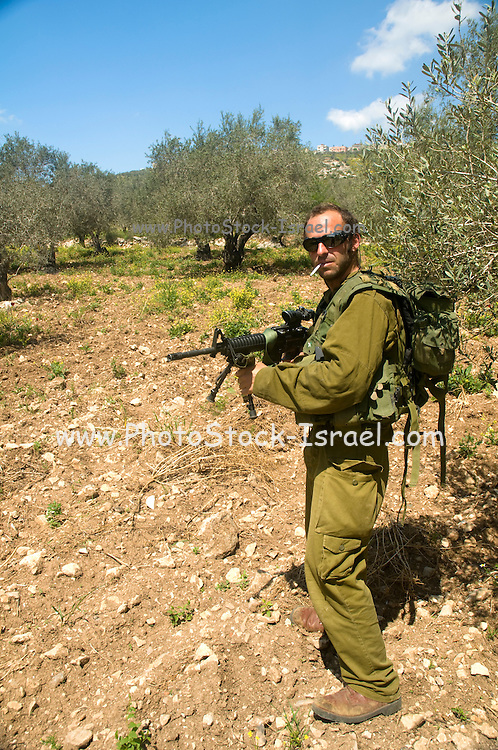 Israel, West Bank, Israeli reserve soldiers on foot patrol during active duty