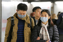 © Licensed to London News Pictures. 30/01/2020. London, UK. People travelling on the underground are seen wearing face masks following the outbreak of Coronavirus in Coronavirus in Wuhan, China. Fight carrying 200 British nationals from Wuhan airport in China to the UK will leave Wuhan this evening at 9pm, UK time. Photo credit: Dinendra Haria/LNP