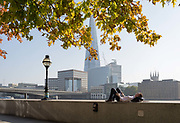 An office worker in the City of London - the capitals financial district - enjoys late summer temperatures on Hanseatic Walk that overlooks the Shard skyscraper, London Bridge and the Thames river, on 10th October 2018, in London, England.