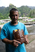 Wood carver, Hanavave, Island of Fatu Hiva, Marquesas Islands, French Polynesia, (Editorial use only)<br />