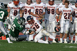 22 October 2005: The Titans Brandin Heidbreder atempts to strip the ball from the Thunders Tim March as he tackles him on the sideline. The Illinois Wesleyan Titans posted a 23 - 14 home win by squeeking past the Thunder of Wheaton College at Wilder Field (the 5th oldest collegiate field in the US) on the campus of Illinois Wesleyan University in Bloomington IL