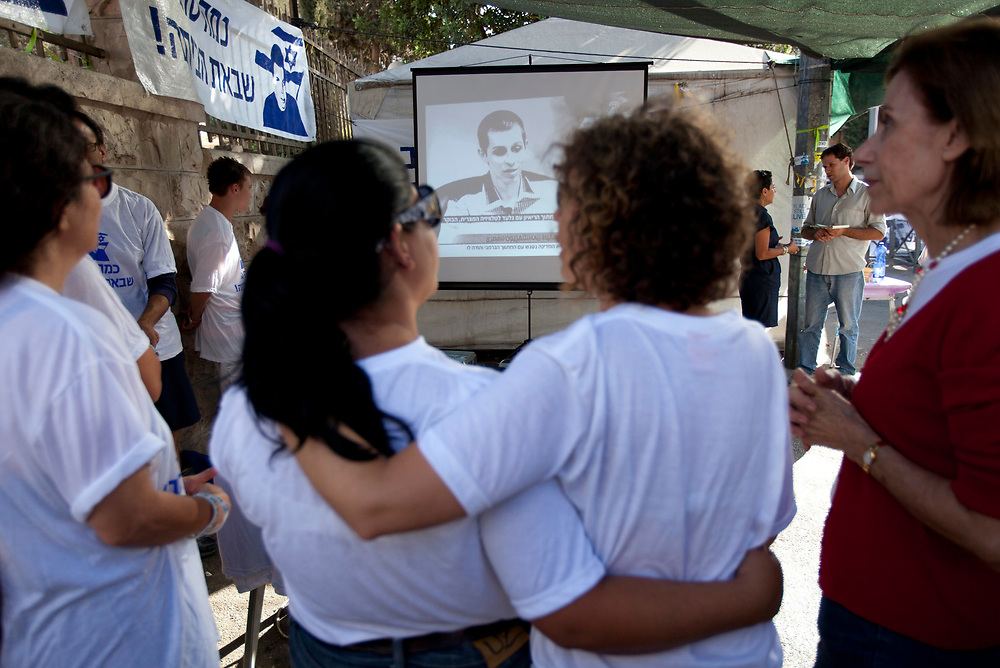 Israelis celebrate as they watch images of Israeli Defense Forces soldier Gilad Shalit on TV following his release on October 18, 2011 outside a protest tent set to call for his release, near Prime Minister Netanyahu's residence in Jerusalem, Israel. Shalit was freed after being held captive for five years in Gaza by Hamas militants, in a deal which saw Israel releasing more than 1,000 Palestinian prisoners.