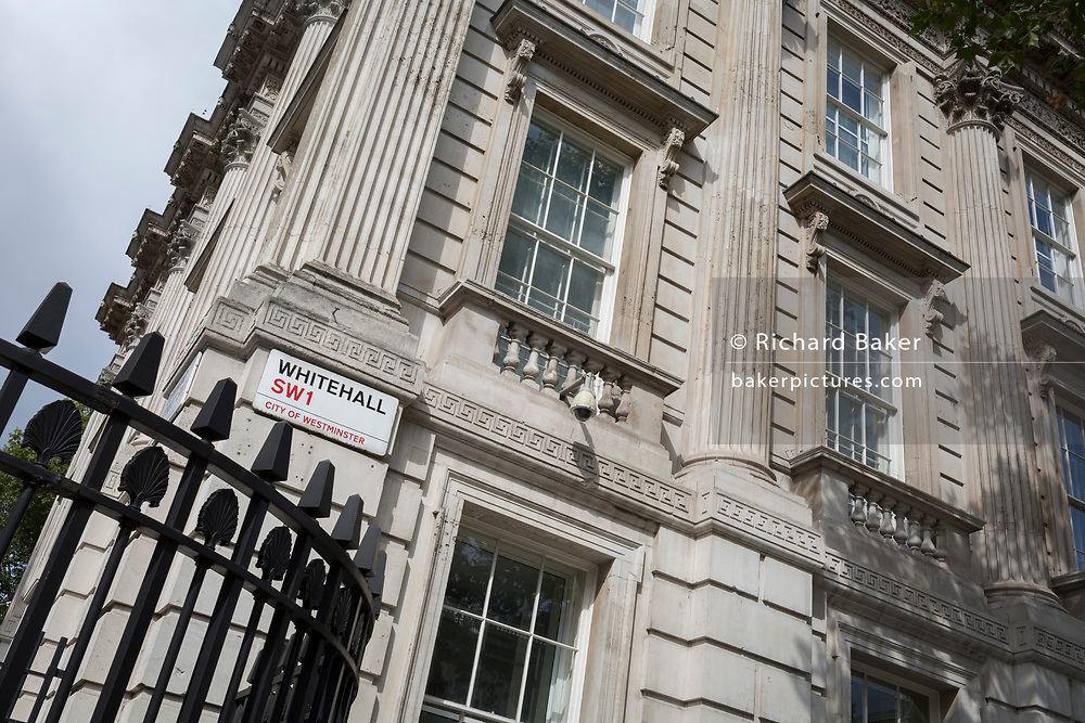 A signpost for Whitehall at the corner of Downing Street, the official residence and office of British Prime Minister Boris Johnson amnd the district in Westminster for British government offices, on 19th August 2019, in London, England.