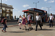 Commuters walk southwards over London Bridge, from the City of London - the capital's financial district founded by the Romans in the 1st century - to Southwark on the south bank, on 6th August 2018, in London, England.