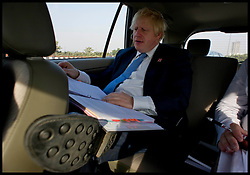 London Mayor Boris Johnson working in his car in Delhi, on Day 2 of his 6 day tour, where he will be trying to persuade Indian businesses to invest in London, Monday November 26, 2012. Photo by Andrew Parsons / i-Images