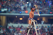 Zack Ryder celebrates after winning the WWE Intercontinental Championship in a ladder match during WrestleMania on April 3, 2016 in Arlington, Texas.