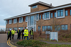 © Licensed to London News Pictures. 08/02/2020. Milton Keynes, UK. Contractors walk past Nightingale House at the Kents Hill Park Training and Conference Centre. A Milton Keynes conference centre is to house evacuees from the Chinese city of Wuhan, the epicentre of the Novel Coronavirus (2019-nCoV) outbreak, the British citizens are due to be flown back on Sunday 9th February and are expected to land at RAF Brize Norton in Oxfordshire and will remain at the Kents Hill Park Training and Conference Centre for 14 days to be monitored. Photo credit: Peter Manning/LNP