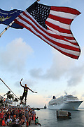 Key West, Florida.  Will Soto performs on tight rope at the Sunset Celebration.
