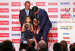 BARCELONA, SPAIN 20TH OCTOBER 2016:<br /> Luis Suarez receives the trophy Golden Boot by their children, in Barcelona, Spain on the 20th October 2016
