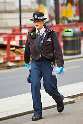 © Licensed to London News Pictures. 27/08/2018. LONDON, UK.  General view of the scene on Regent Street where a car has crashed into the Hunters shop. The incident is believed to have occurred while it was being chased by police and a pedestrian was injured. IN THIS PICTURE: A police woman carrying a evidence bag that appears to contain blood stained 20 pound notes.  Photo credit: Cliff Hide/LNP