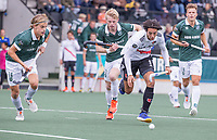 AMSTELVEEN - Valentijn Charbon (Amsterdam) met Jochem Bakker (Rotterdam) , Justen Blok (Rotterdam) , Thijs van Dam (Rotterdam)  tijdens de competitie hoofdklasse hockeywedstrijd heren, Amsterdam -Rotterdam (2-0) .  COPYRIGHT KOEN SUYK