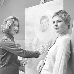 The latest candidate for celebrity portrait painter June Mendoza (l) at her studio in Inner Park Road, London, is York-born actress Judi Dench.