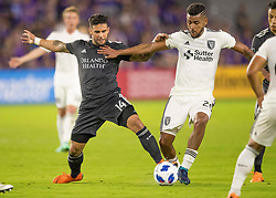 April 21, 2018 - Orlando, FL, U.S. - ORLANDO, FL - APRIL 21: Orlando City forward Dom Dwyer (14) blocks a pass from San Jose Earthquakes midfielder Anibal Godoy (20) during the MLS soccer match between the Orlando City FC and the San Jose Earthquakes at Orlando City SC on April 21, 2018 at Orlando City Stadium in Orlando, FL. (Photo by Andrew Bershaw/Icon Sportswire) (Credit Image: © Andrew Bershaw/Icon SMI via ZUMA Press)