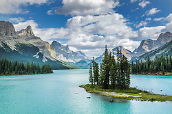 """A pretty day at Maligne Lakes Spirit Island. Canadian Icon, Spirit Island with her centennials of  the Queen Elizebeth Range towering around. When artist and explorer Mary Schaffer became the first European to lay eyes on Maligne Lake in 1908, she called it """"the Hall of Gods,"""" adding that """"if Lake Louise is a pearl, Maligne is the entire pearl necklace.""""<br /> <br /> This compositionally perfect landscape has yet to be captured perfectly be me, I look forward to returning again and again."""