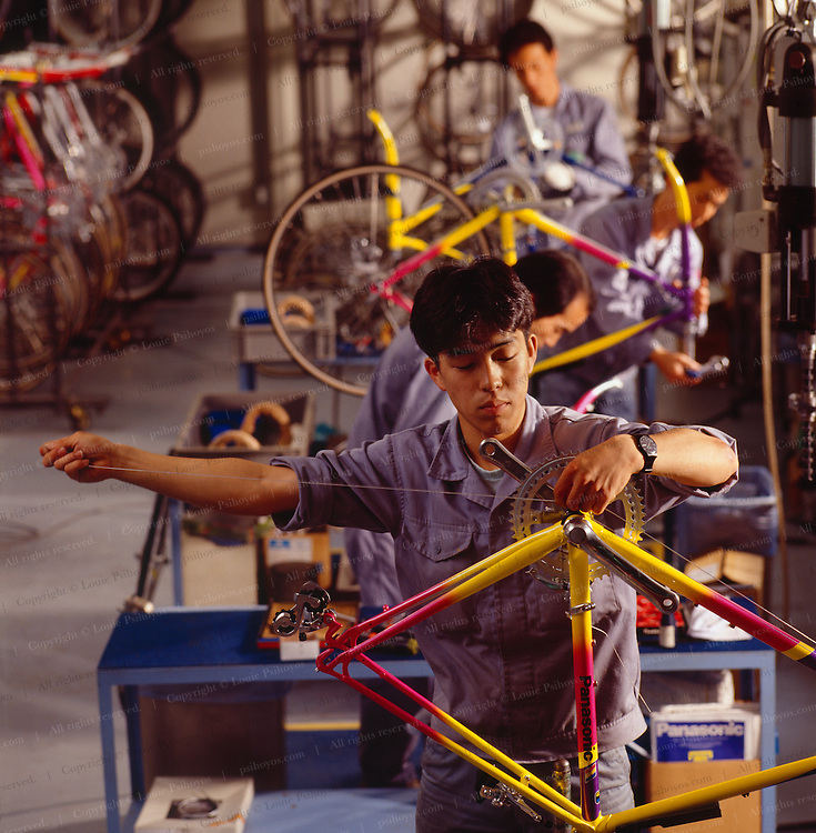 The final step in creating the custom bike is the hand assembly of the components.  This is done by four skilled craftsmen.<br /> Basic assembly, such as the wiring of this brake cable is left for humans, not robots.  One worker assembles nearly the entire bike and in the process derives a sense of accomplishment that is often missing from assembly line jobs.