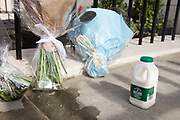 "London, UK. Monday 8th April 2013. Bottle of milk satirically left next to messages of condolence the London residence on Chester Square of Baroness Margaret Thatcher following the announcement of her death. In 1971 Thatcher announced the end of free milk to the over-sevens  which earned her the name 'Thatcher milk snatcher'. Maggie Thatcher (87), aka the ""Iron Lady"" dominated British politics for 20 years, died peacefully on 8/4/13 following a stroke."