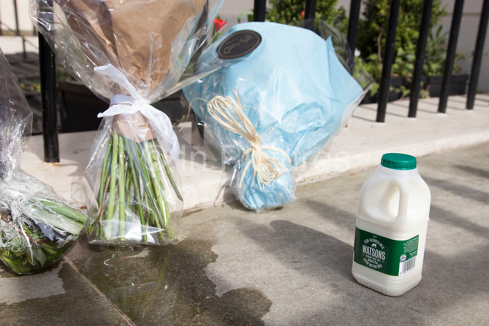 """London, UK. Monday 8th April 2013. Bottle of milk satirically left next to messages of condolence the London residence on Chester Square of Baroness Margaret Thatcher following the announcement of her death. In 1971 Thatcher announced the end of free milk to the over-sevens  which earned her the name 'Thatcher milk snatcher'. Maggie Thatcher (87), aka the """"Iron Lady"""" dominated British politics for 20 years, died peacefully on 8/4/13 following a stroke."""