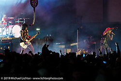 Vince Neil and Nikki Sixx of Motley Crue perform on the main stage of the Sturgis Buffalo Chip during the Black Hills Motorcycle Rally. SD, USA. August 5, 2014.  Photography ©2014 Michael Lichter.
