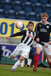 Dunfermline's Josh Falkingham and Falkirk's Jay Fulton..half time : Falkirk v Dunfermline, 16/2/2013..©Michael Schofield.