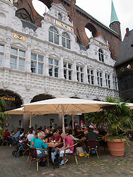 Outdoor cafe in market square next to Rathaus in Lubeck Germany