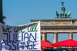 18-05-2019 GER: Berlin is the capital and largest city of Germany, Berlin<br /> <br /> Demonstration for the freedom of Julian Assange. In the background The Brandenburger Tor (Brandenburg Gate)  the most important gate in Berlin