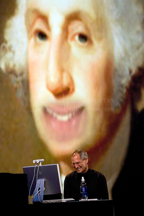 SAN FRANCISCO - JUNE 11: Apple CEO Steve Jobs laughs at an image of George Washington as he delivers the keynote speech at the Apple Web Developers conference at the Moscone Center on June 11, 2007 in San Francisco, California. During his keynote, Jobs demonstrated new features in the Leopard operating system that will be released in October.  (Photograph by David Paul Morris)