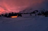 New Henry M Jackson visitor center at Paradise after sunset with warm alpenglow and warm light glow from the visitor center and climbing center at Paradise on the slopes of Mount Rainier, Mount Rainier National Park, Cascade Mountain Range, Washington, USA